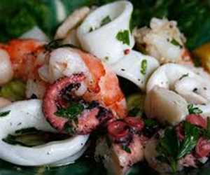 Calamari salad, different each week, can be found in the seafood display cooler.