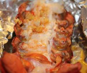 Wrap our lobster tails loosely in foil after adding garlic butter & grill or bake for 12 mins small or 22 mins large.