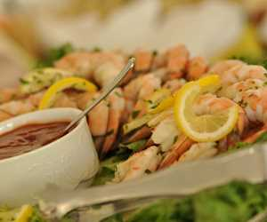 Our cocktail shrimp are poached with lemon, bay leaf & peppercorn ~ Dora's family recipe